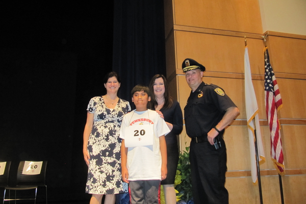 North Street School's Royce Bacay won the 4th Grade Spelling Bee. He is joined by judges Nicole Boc and Deputy Police Chief John Voto.