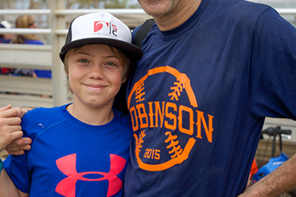 Luke and Dave Fratello: In role reversal, Luke Fratello, who plays in Manhattan Beach Little League, got to support his dad Dave, who managed the Robinson Elementary School team in the MBX Parents Softball Classic.