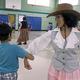 Teacher Maria Eydenberb dances with 2nd grader Eshaan Potnis