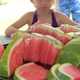 That's a whole lotta watermelon for one little girl!