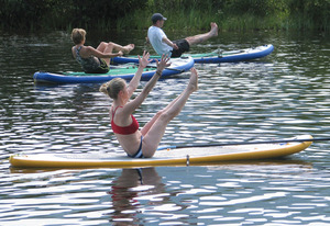 SUP yoga enthusiasts find their form at Fetcher Pond along the Yampa River Core Trail  Photo courtesy Steve Z Photography