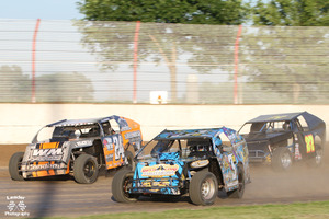 IMCA Modifieds of Aaron Muhle Mike Mueller 3 and Frank Firari 27 photo by Larry Douma - Leader Photography