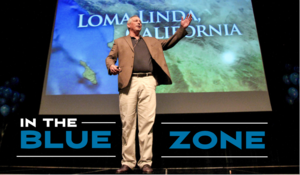 Tony Buettner on the Beaver Dam High School Auditorium stage Blue Zones presentation June 16 2015 Photo Dan Baulch