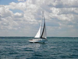 Medium sailboat in the ocean wallpaper  yvt2