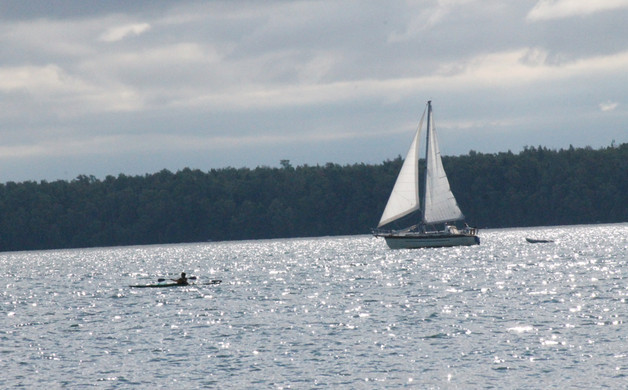 Sailboat and Kayaker