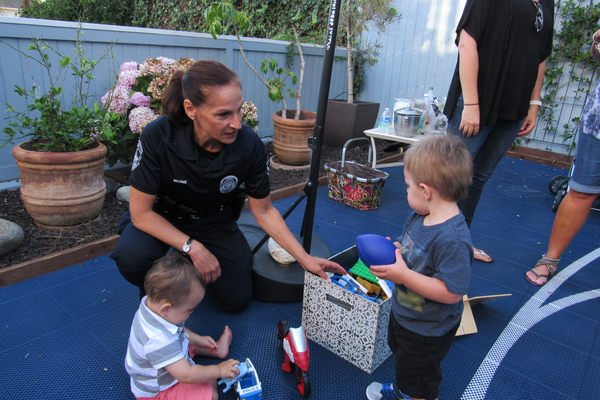 MBPD Police Chief Eve R. irvine greets youngsters at one of the National Night block gatherings in the city.