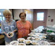 COA Board Chairman Rita Tetreault and Program Manager Sheila Ronkin with the pie
