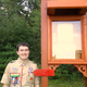 Sean Boddy at the trail kiosk he built