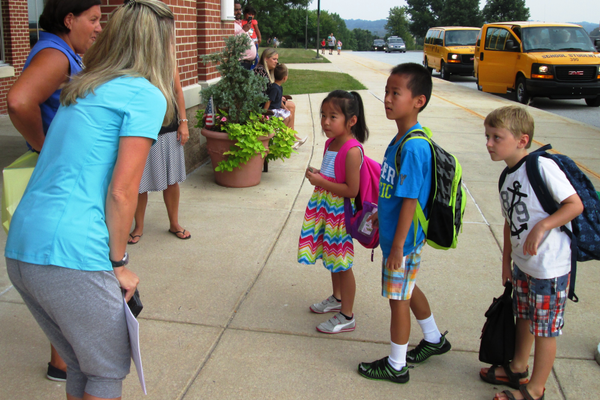 Teachers greet students as they get off the school bus at Pocopson Elementary on Monday morning.