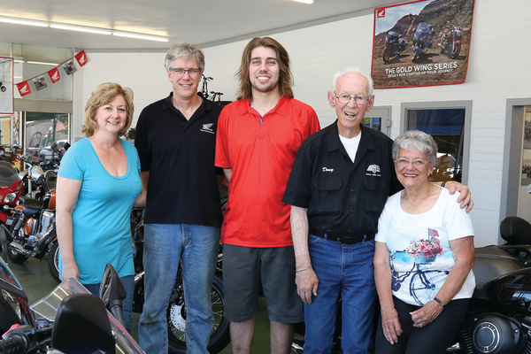 The Wilson family has sold motorcycles for nearly 100 years, spanning four generations. Three of those generations are pictured here, including Lisa Wilson, Robert Wilson, Kyle Wilson, Doug Wilson and Coleen Wilson Photo by Dan Minkler.