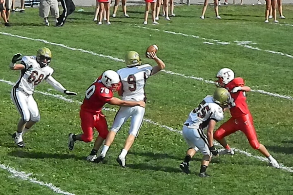 Senior defensive lineman Kevin VonKahle pressures Austin Hoey (9) into throwing the ball away.