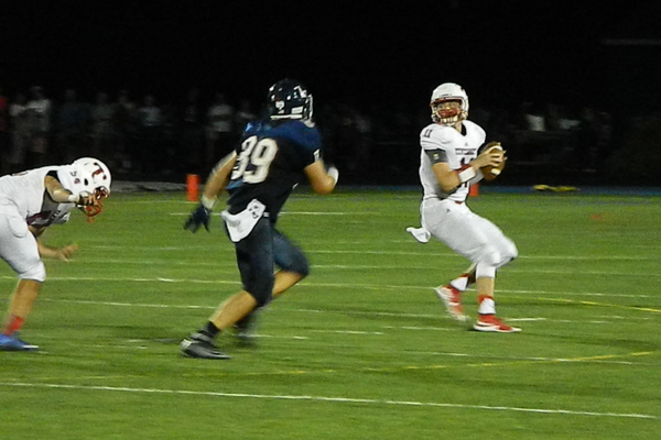 Senior quarterback Brett Morris (11) drops back to pass.