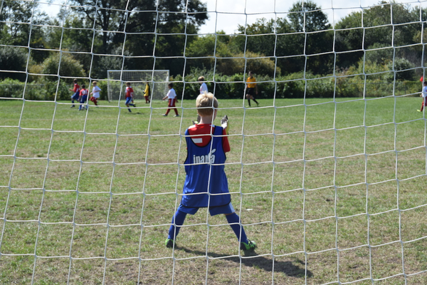 Goaltender Kyle adjusts his gloves, as the Tewksbury U10 Boys soccer team did battle with Melrose on Saturday under sunny skies at the Frasca Fields complex.