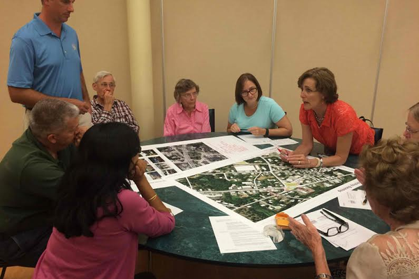 Residents participate in a breakout session at the Town Center Visioning Session last week at the Senior Center.