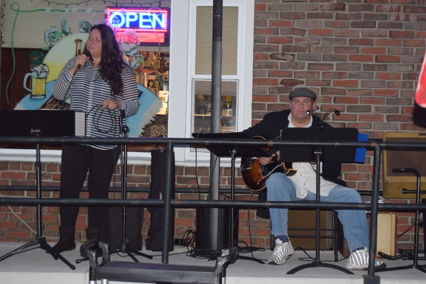 The talented Alan Paul Duo entertains patrons at Cafe Sicilia.