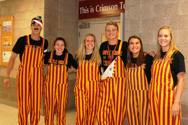 "Maple Grove Senior High staff prepare for the Crimson Homecoming ""Dance Off"" during Pepfest"