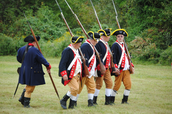 A marching demonstration by reenactors.