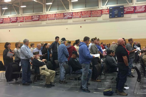 Voters stand to be counted at the Special Town Meeting.