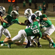 Another Dragon gang tackle led by senior captain Grant McFarlin (36). The Dragons held Richland to a 52-21 victory. Photo by S. Johnson/Snapped Dragons