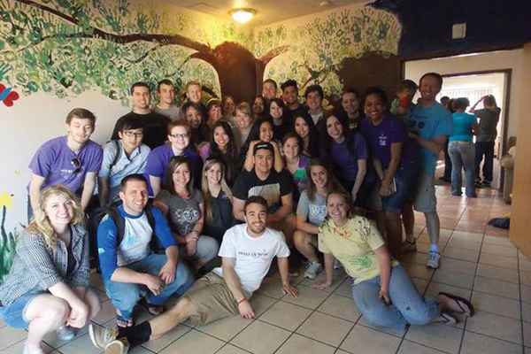 Students who participated on a Weber State University Alternative Spring Break trip helped out at food banks and elementary schools in Las Vegas. Amina Kahn can be seen a little left of center.