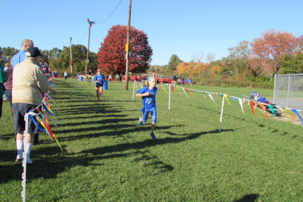 Makayla Paige crosses the finish line.