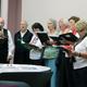 Linda Trudeau (left) leads members of the Bellingham Senior Community Chorus