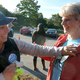 """Safe Routes to school committee member Dana Tubman gives Principal Carolyn Rafferty her """"I walked to School"""" sticker."""