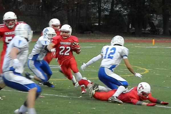 Troy Carey (22) finds a hole in the Danvers defense.
