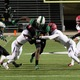 Southlake Carrol RB Lil' Jordan Humphrey breaks through the Cedar Hill defense in the first round of the 2015 UIL football playoffs.  Humphrey accounted for 289 yards and three TDs as the Dragons defeated Cedar Hill 37-33 at Dragon Stadium.  Photo by S. Johnson/SnappedDragons.com
