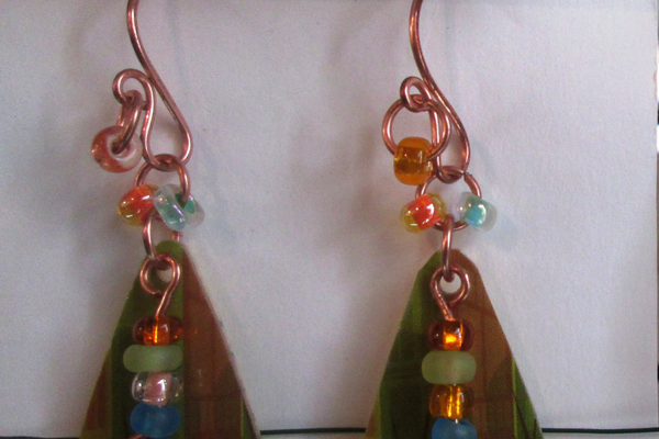 Earrings made from recycled plastic gift cards.