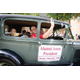 Alumni Association President John Mackie riding in the Grove City College homecoming parade.