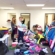 Youth Participants (Left to right) Rylan Kono, Emma Whitmarsh, Ellen Smolarski, Kelly McMillen, Joseph Dalessi, and Brenden Groess, set up all the clothing donations for the winter boutique.