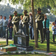 Community members and volunteer honor guards from the Fresno County Sheriff's Department stand in quiet witness to the interment.