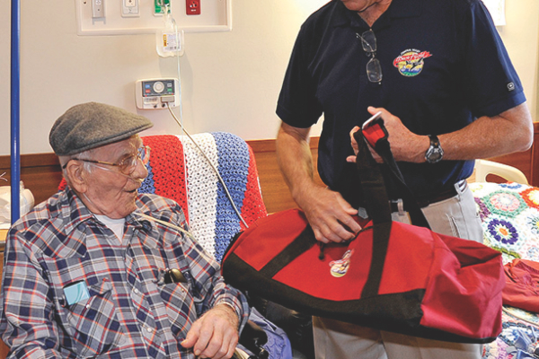 "Al Perry visits with Robert Metzler as part of the ""No Veteran Dies Alone program."" Metzler fought with General Patton at Battle of the Bulge, Bastogne, and Bridge at Remagen. Metzler passed away in October . Photo provided by Al Perry, taken at Veterans Administration in Fresno."