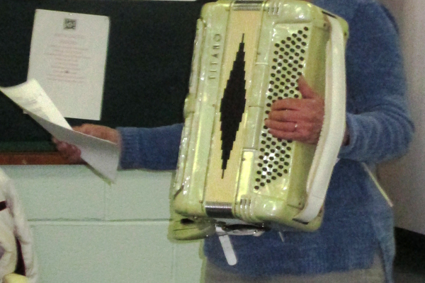 Accordionist Judy Wadsworth introduces a song during a recent concert.