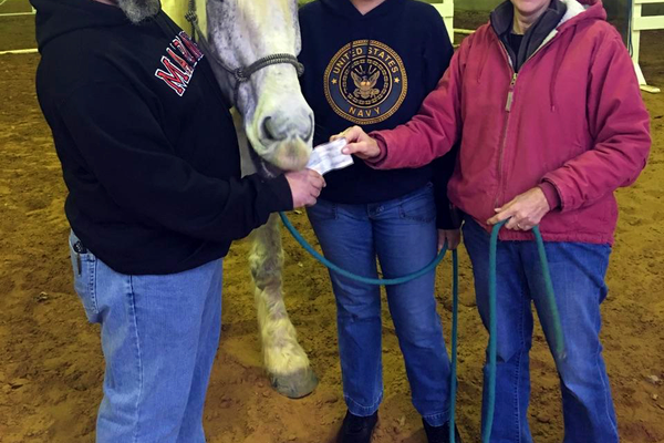 Donating to the All Star Equestrian Foundation (Moses the Horse is actually trying to eat the check in this picture). Photo courtesy of Andrew Postell.