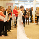 A model poses in a beautiful lace gown during the Bridal Fashion Show, hosted by Annapolis Formal & Tuxedos