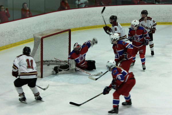 Maple Grove's Hailey Herdine (11) scores against Spring Lake Park-Coon Rapids