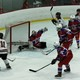Maple Grove's Hailey Herdine (11) scores against Spring Lake Park-Coon Rapids