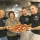 Giovani Lubrano Maria Lubrano Claudio Lubrano and Marco Lubrano display a Brooklyn margherita pizza at Sfizio Pizza on April 15 2016 Photo by Suzette J Lucas