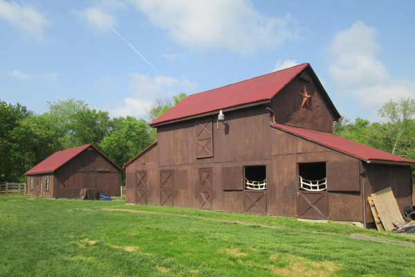 The two smaller barns on the property.