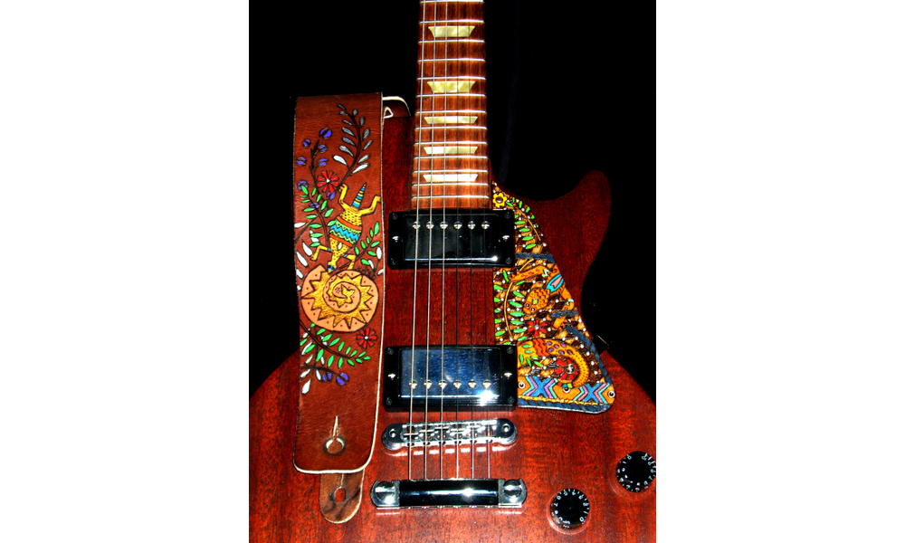 Asti Has Now Created Burned Designs On Guitar Straps And Pick Guards