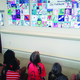 Students admire their work at the unveiling of their mural.—Kelly Cannon