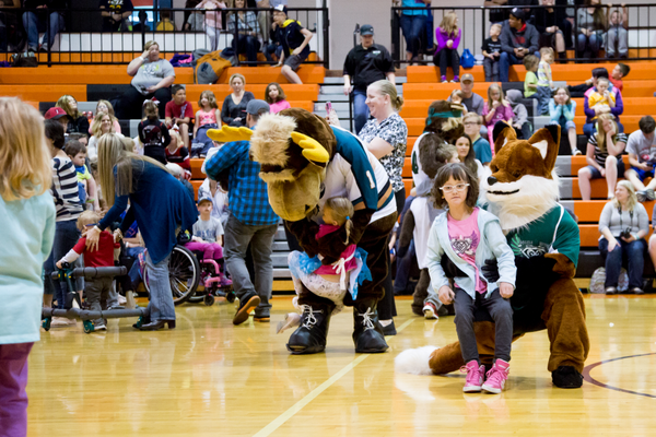 Audience members hugged and interacted with the mascots during the Pep Rally. – Camera Shy