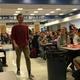Dallin Bentley walks up to the front of the Bingham High School lunchroom to accept a $20,000 scholarship from Footlocker. – Tori La Rue