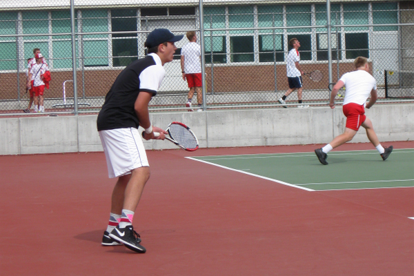Brevin Elsholz, senior No. 1 singles, prepares to return a serve during a match against East on April 29. – Travis Barton