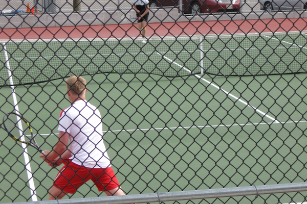 Sam Nelson, senior No. 2 singles, serves against East on April 29. The Rams entered the region tournament with a 3-3 record in region play. – Travis Barton