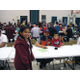 A father and his two kids participate in Columbia Elementary School's science night, surrounded by hundreds of other participants. – Stacey Leavitt