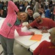 Dads and their kids pose for a picture at Columbia Elementary School's first Dad and Kid Science Night. – Stacey Leavitt
