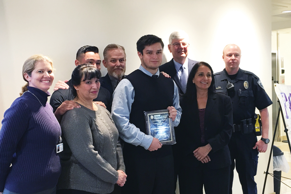 "Trevor VanRoosendall, of Riverton High School, holds his ""Student of the Year"" plaque, surrounded by his family, principal, mayor, president of the local Footprinters chapter and the officer who nominated him for the award. –Tori La Rue"
